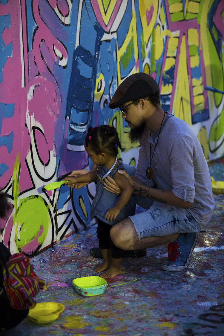 The cultural council of greater jacksonville asks 10 questions to christopher clark with his daughter painting jax mural project at art walk 032017 photo credit toni smailagic of cre8jax solutioingenieria
